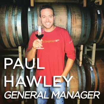 Paul Hawley holding a glass of wine