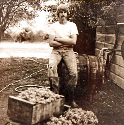 John Hawley sitting on barrel
