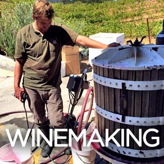 austin hawley working on wine press