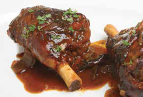 image of Braised Lamb Shanks covered with Pinot Noir sauce