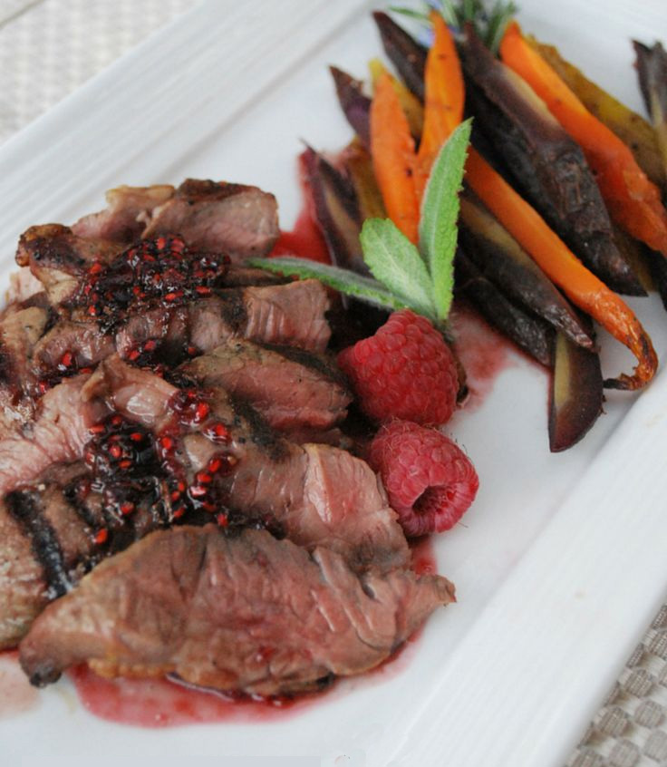 image of Lamb with Spicy Mint Raspberry Glaze with garnish and veggie fries