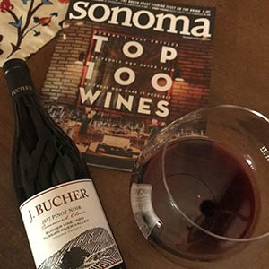 A glass of Bucher Pinot atop a copy of Sonoma Magazine's Top 100 Wines issue featuring Bucher Wines'