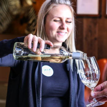 Carolyn pouring wine