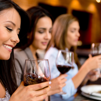 Girls enjoying wine