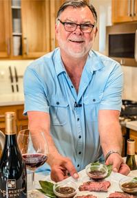 Chef Jim serving steak