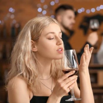Blond Girl Tasting Wine