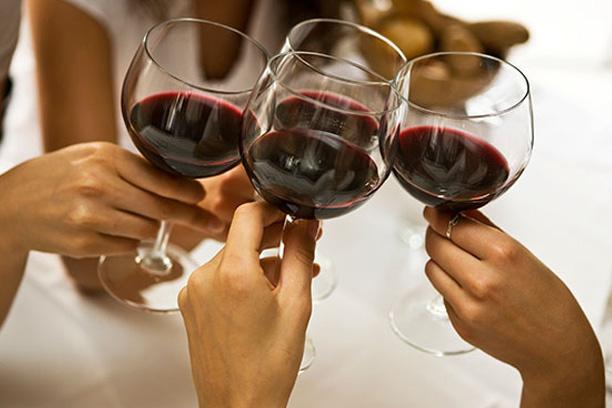 Three wine glasses toasting
